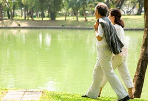 couple_walking_by_pond